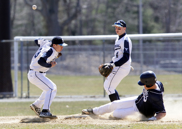 Peabody: Peabody shortstop Ryan Collins, left, can't handle a throw from catcher Brandon Polignone, as St. John's Prep's David Bornstein slides safely into second base as Tanner teammate Matthew McIsaac looks on. The Eagles handily took down the Tanners 14-1 on Saturday afternoon. David Le/Salem News