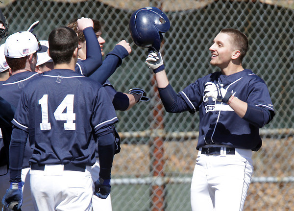 Peabody: Brandon Bingel gets congratulations from his teammates after his two-run home run against Peabody on Saturday afternoon. David Le/Salem News