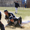 Peabody: Peabody catcher Brandon Polignone and St. John's Prep runner Alex Moore look to the home plate umpire for a call on a close play at the plate. Moore slid under a tag from Polignone to score another Eagles run. David Le/Salem News