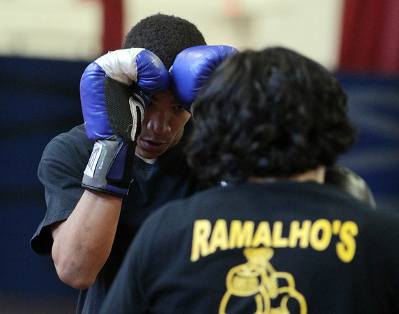 Salem: Salem High School senior Riqui Pacheco spars with classmate Charles Espinal at practice on Monday afternoon in preparation for a boxing showcase being held at Salem High School on Saturday. David Le/Salem News