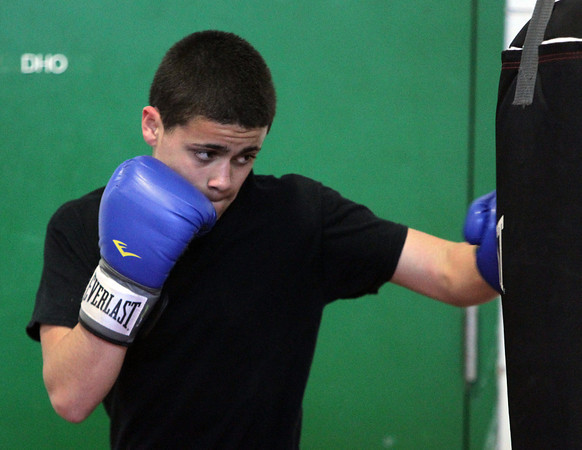 Salem: Sophomore Jonathan Santiago throws punches into a bag at practice on Monday afternoon. David Le/Salem News