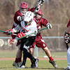 Salem: Salem High School junior attack Peter Slattery manages to get a shot away and beats the Gloucester goalie while being harrassed by two Fishermen defenders. David Le/Salem News