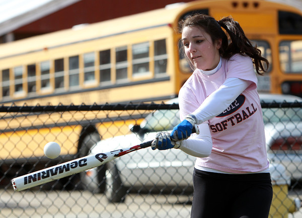 Middleton: North Shore Tech sophomore outfielder Gabby Fagone keeps her eyes on the ball while taking some soft toss swings at practice on Tuesday. Fagone will look to be a key contributed for the Bulldogs this spring. David Le/Salem News