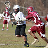Salem: Salem senior attack Matt Wilson, left, protects the ball while being stick checked by a Gloucester player on Tuesday afternoon during the Witches first game of the 2013 season. David Le/Salem News
