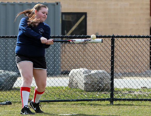Middleton: North Shore Tech junior first baseman Alyssa King makes solid contact during a soft toss drill at practice on Tuesday afternoon. King is one of the returning upperclassmen for the Bulldogs and will be looking to lead them this spring. David Le/Salem News