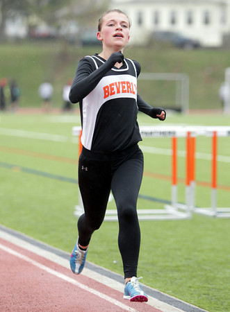 Beverly: Beverly sophomore Maeve Monahan sprints to the finish of the two-mile on Tuesday afternoon. Monahan took first the two-mile to help the Panthers to a win over Salem. David Le/Salem News