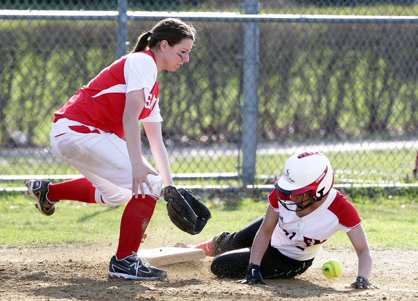 Salem: Salem shortstop Desiree Martin slides safely into third base while Saugus' Talya Murphy tries to field the ball. David Le/Salem News