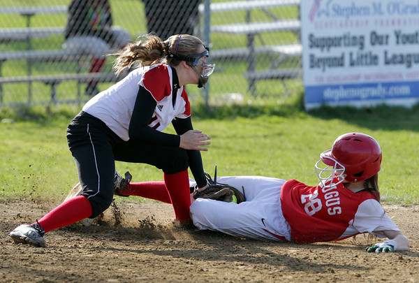 Salem: Salem third baseman Jojo Coleman applies a tag just a bit late to Saugus' Pauline Accolase as she slides safely into the base on a close play. David Le/Salem News