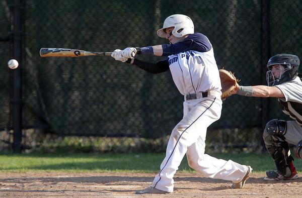 Swampscott: Swampscott second baseman Nunzio Morretti lines a base hit against Salem on Monday afternoon. David Le/Salem News