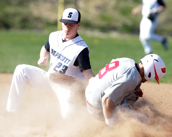 Swampscott: Salem leadoff hitter _____ Mercier slides safely into second base ahead of the tag from Swampscott shortstop Greg Collier. David Le/Salem News