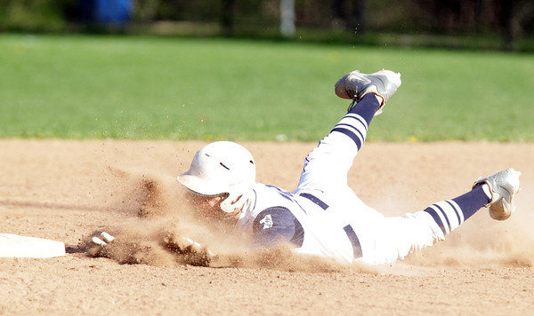 Swampscott: Swampscott's Trevor Massey slides through a cloud of dust and safely into second base for a double against Salem on Monday afternoon. David Le/Salem News