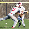 Swampscott: A short popup falls between a lunging _____ Mercier, left, and ______ Ryan for a hit. David Le/Salem News