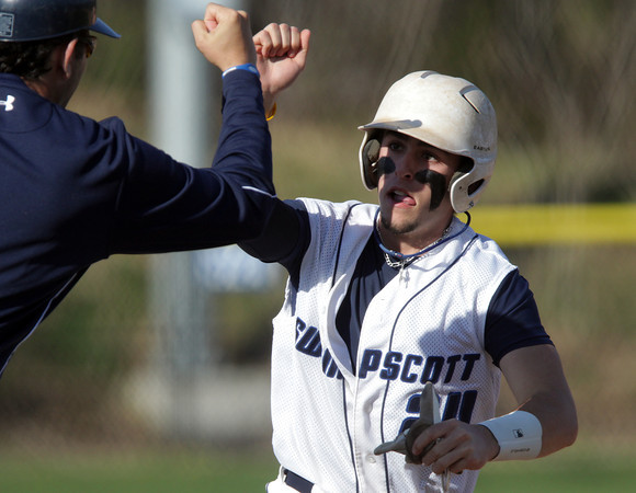 Swampscott: Swampscott third baseman Corey Carmody gets a high five from his third base coach after hitting a grand slam against Salem on Monday afternoon. David Le/Salem News