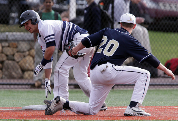 Danvers: St. John's Prep senior Tyler Noe slides safely into third base ahead of the tag from the Malden Catholic third baseman. David Le/Salem News