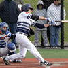 Danvers: St. John's Prep sophomore Keith Leavitt lines a single to left against Malden Catholic on Monday afternoon. Leavitt hit a solo home run to tie the game a 1-1, and the Eagles went onto win 3-1 while wearing special alternate jerseys in support of former St. John's and Boston College standout Pete Frates in his fight with ALS. David Le/Salem News