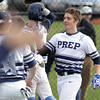 Danvers: St. John's Prep sophomore Keith Leavitt gets high fives from his teammates after crossing home plate after he hit a solo home run, tying the game at 1-1 against Malden Catholic on Monday afternoon. David Le/Salem News