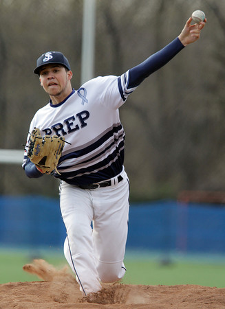 Danvers: St. John's Prep junior starting pitcher Justin Snyder fires a strike against Malden Catholic on Monday afternoon. Snyder allowed a first inning run, but settled down afterwards, pitching 6 1/3 innings and only allowing the one run to pick up the win for the Eagles. David Le/Salem News