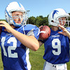 Danvers High School junior Ryan Chasse, left, and sophomore Nick Andreas, right, look to battle for playing time under center this year for the Falcons. David Le/Staff Photo