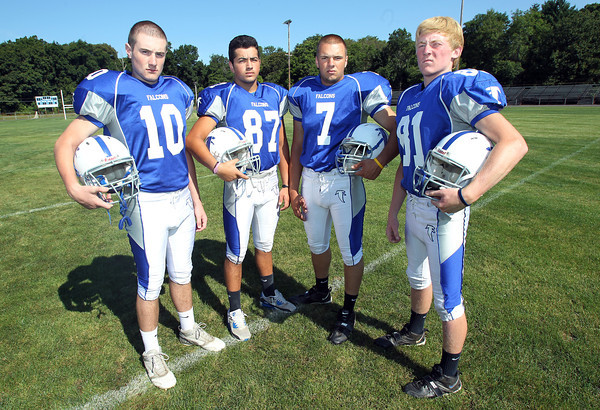 From left, Danvers High School senior tight ends, Max McKinnon, Theo Hatzelamprou, Justin Woodbury, and senior captain wide receiver Jake Cawlina, look to provide offensive firepower for the Falcons in 2012.  David Le/Staff Photo