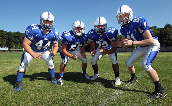 From left, Danvers High School senior captains Alex Grant, Connor Morrison, Joe Manson, and Jake Cawlina, look to lead the Falcons to a successful 2012 campaign. David Le/Staff Photo
