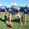 Danvers High School senior offensive linemen, guard Joe Manson, center Matt Irving, and guard Connor Morrison look to provide leadership for the Falcons in the Fall of 2012. David Le/Staff Photo