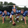 The 2012 Tanners will be anchored by their experienced offensive line including senior co-captains from left, Frank Lowry, Max Gordon, Jared Vachon, and Brian Norwood, and sophomore Ethan Mercedes, and look to block for junior quarterback Cody Wlasuk. David Le/Staff Photo