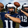 Swampscott High School junior Brendan McDonald, left, and senior captain Brian Santry, right, will be battling for playing time as signal caller for the Big Blue in the upcoming 2012 season. David Le/Staff Photo