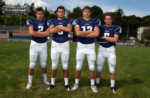 From left, Swampscott High School senior captains Josh Rothwell, Aaron Cronin, Brian Santry, and Robert Serino will lead the Big Blue in the 2012 season. David Le/Staff Photo