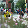 Salem: Riders in the Men's Elite race of the Witches Cup make a sharp turn around a flower bed on the back stretch on Wednesday evening. David Le/Salem News
