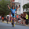 Salem: Seventeen-year-old Curtis White raises both fists high in the air as he outraced the rest of the lead pack down the straightaway to win the 2013 Men's Elite Race of the Witches Cup. White's fifteen-year-old sister Emma, won the Women's Elite race an hour earlier. David Le/Salem News