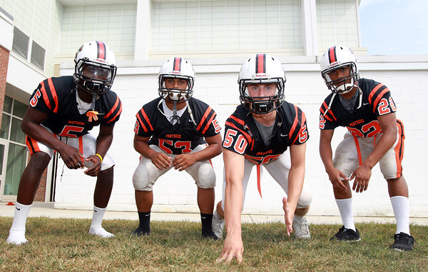Beverly: From left, Beverly High School seniors Sam Mulumba (OLB), Sean Winston (MLB), Zach Duguid (DE), and Isiah White (OLB), will look to anchor the Panther defense in 2013. David Le/Salem News