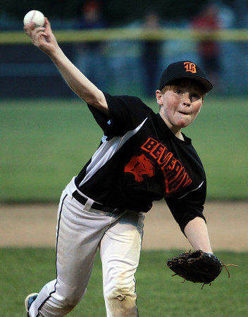 Beverly: Beverly starting pitcher Matt Collins fires a pitch during the first inning of play on Thursday evening. David Le/Salem News