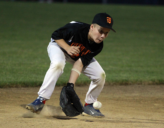 Beverly: Beverly shortstop Justin Loreti cleanly fields a grounder and fires to first to throw out a runner to end the second inning of play. David Le/Salem News