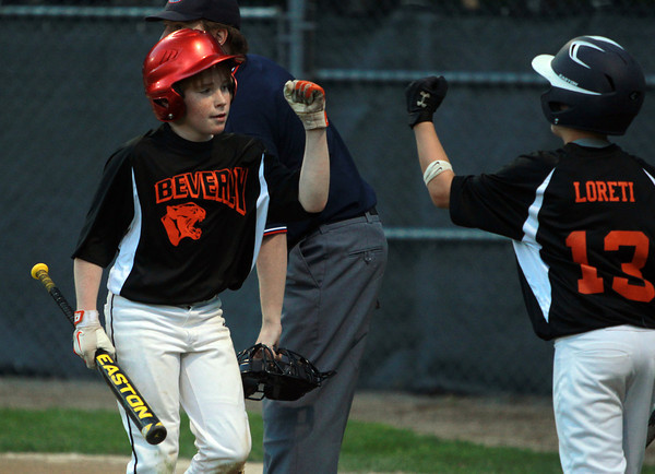 Beverly: Beverly starting pitcher Matt Collins gets a fist bump from teammate Justin Loreti after Collins scored the first run of the game on a Ryan Barror double. David Le/Salem News