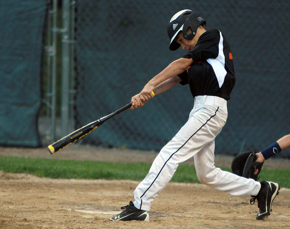 Beverly: Beverly's Ryan Barror lines an RBI double in the top of the first inning against Danvers. David Le/Salem News