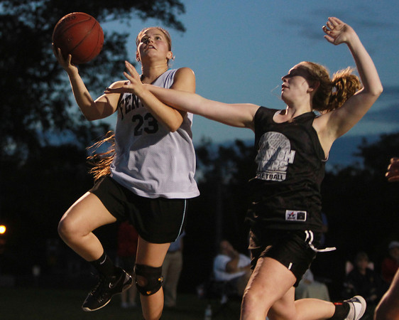Danvers: Bishop Fenwick's Gianna Pizzano, left, drives to the hoop while getting fouled by Ipswich's Hanna Stasiok, right, on Tuesday evening. David Le/Salem News