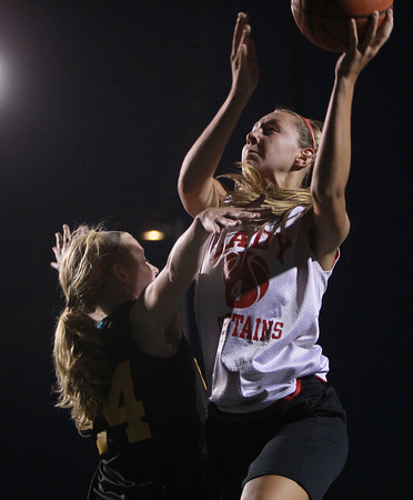 Danvers: Masco's Nicole Femino, right, rises over Bishop Fenwick's Colleen Corcoran, for two points on Wednesday evening. David Le/Salem News