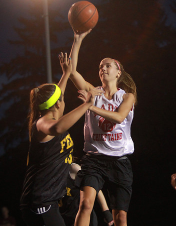 Danvers: Masco's Hannah Kiernan, right, releases a floater over Bishop Fenwick's Chandler Wilder with a few seconds on the clock in the first half. David Le/Salem News