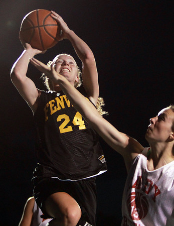 Danvers: Bishop Fenwick's Colleen Corcoran, left, goes up for a contested layup while being pressured by Masco's Katie Kitsakos, on Wednesday evening. David Le/Salem News