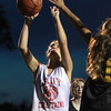 Danvers: Masco's Janelle Shay, left, drives hard to the hoop against Bishop Fenwick on Wednesday evening. David Le/Salem News