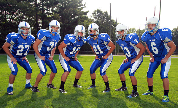 Danvers: The 2013 Danvers Falcons will be led by a large group of running backs including senior captains Anthony Cordoba (16), and Alex Valles (21). From left, Chris Behen (27), Richie Martino (31), Cordoba, Valles, John Thomas (23), and Danny Lynch (6). David Le/Salem News