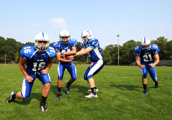 Danvers: Danvers High School running backs senior captain Anthony Cordoba (16), junior John Thomas (23), and senior captain Alex Valles (21), will look to pace the Falcon offense in 2013 along with junior signal caller Nick Andreas (9). David Le/Salem News