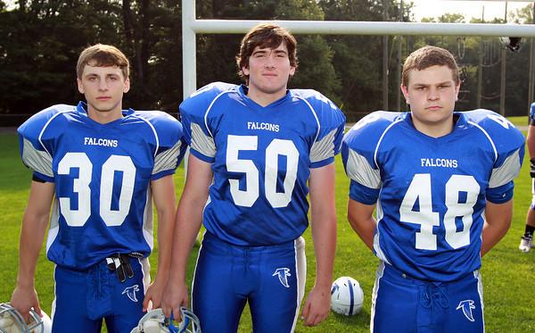Danvers: From left, Danvers High School Football seniors Artyom Nabokin (30), Brian Daly (50), and CJ Mansfield (48). David Le/Salem News