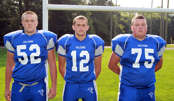 Danvers: From left, Danvers High School Football seniors Tom Quinn (52), Ryan Chasse (12), and Adam Tibbetts (75). David Le/Salem News