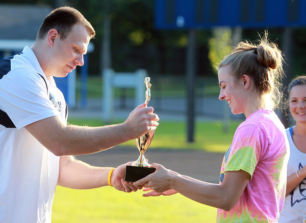 Hamilton: Hamilton-Wenham Girls Basketball Head Coach Jon DeMarco hands out the first place trophy of the first Iron Woman Competition to senior Haley Willis, on Thursday afternoon. David Le/Salem News