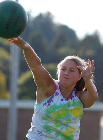 Hamilton: Hamilton-Wenham senior Leslie Bynum heaves a medicine ball during the first Iron Woman Competition at Hamilton-Wenham High School on Thursday afternoon. David Le/Salem News