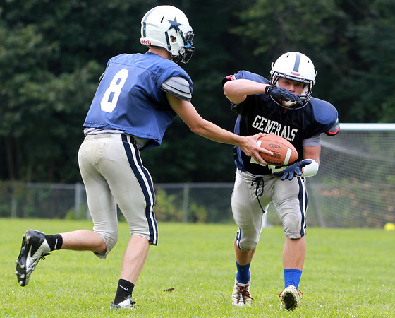 Hamilton: Hamilton-Wenham sophomore running back Cam Macri, right, takes a handoff from senior quarterback Jack Clay, left, at practice on Thursday afternoon. Macri and Clay will look to lead the Generals back to the playoffs in 2013. David Le/Salem News