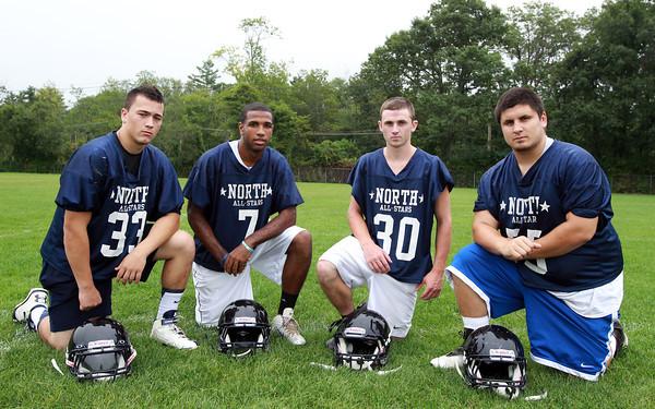 Middleton: From left, North Shore Tech Football Captains junior Daniel Bailey, junior Yordany Sanchez, senior Ian Lefavour, and senior John Sabbio. David Le/Salem News