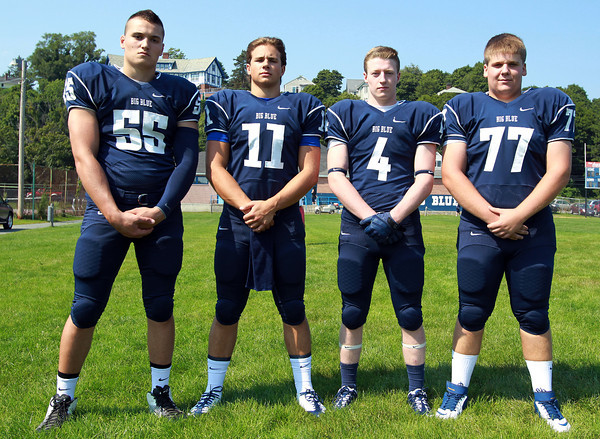 Swampscott: From left, Swampscott High School senior football captains, Toby Hale, Brendan McDonald, Ben Faulkner, and Justin Nestor. David Le/Salem News