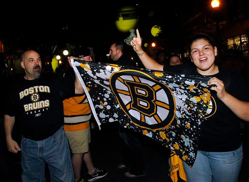 Boston Bruins fans celebrate near TD Garden in Boston Wednesday, June 15, 2011, after the Bruins defeated the Vancouver Canucks 4-0 in Game 7 of the NHL hockey Stanley Cup Finals in Vancouver, British Columbia. (AP Photo/Elise Amendola)